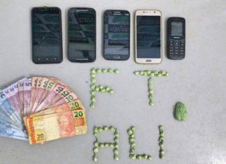 Dinheiro, drogas e celulares apreendidos na ação policial – Divulgação PM